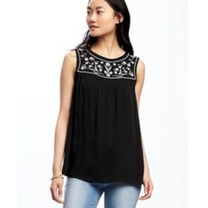 black babydoll top with white embroidery